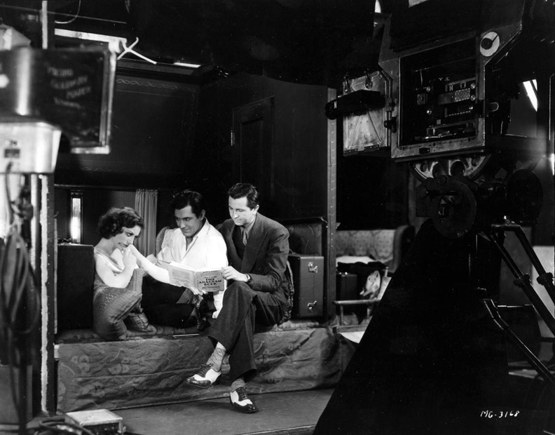 Joan Crawford, Johnny Mack Brown and Malcolm St. Clair behind the scenes during filming of Montana Moon
